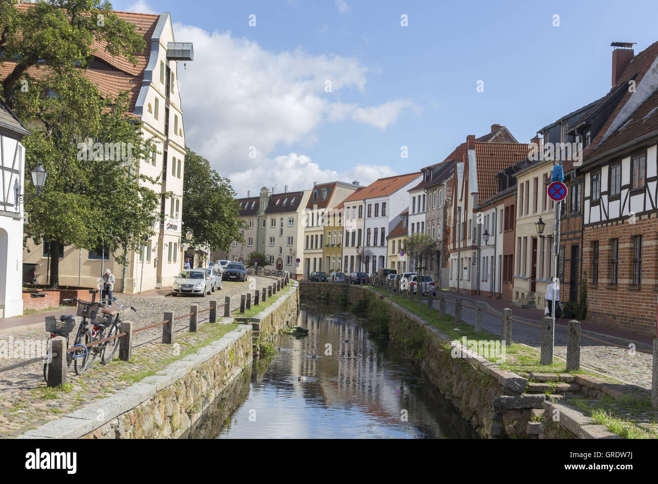 Canal With Natural Stone Enclosure Near The Port Of Wismar - Stock Image