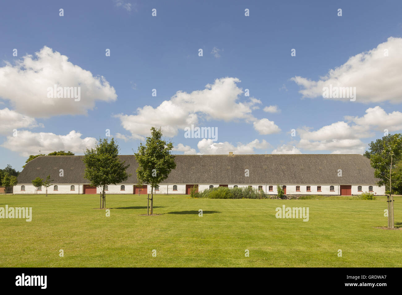 Elongated, White Stables In The Park At Fuglsang - Stock Image