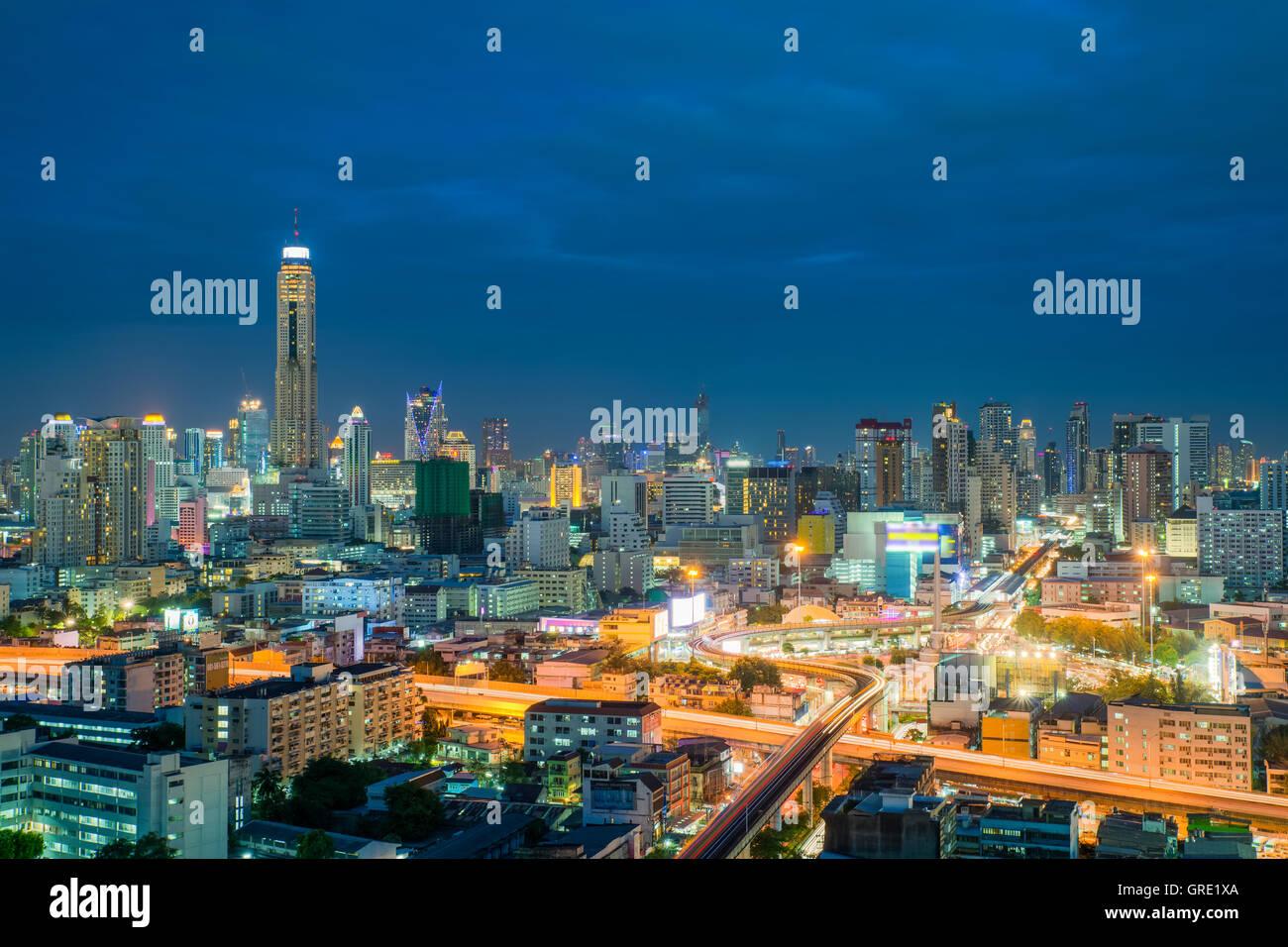 Bangkok city skyline and Bangkok skyscrapers building at night in Bangkok city, Thailand. - Stock Image
