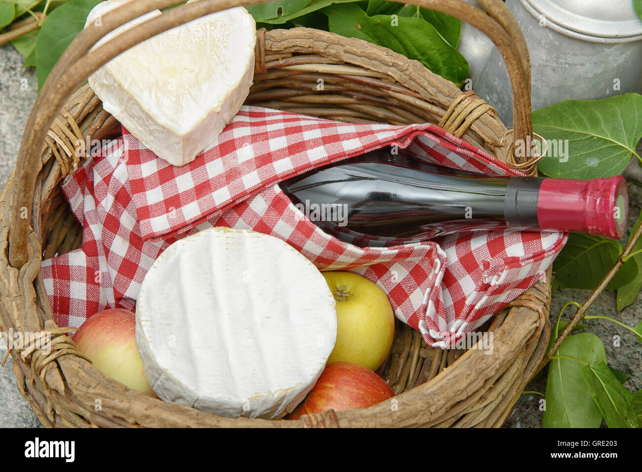 Camembert and Neufchatel cheese with bottle of wine - Stock Image