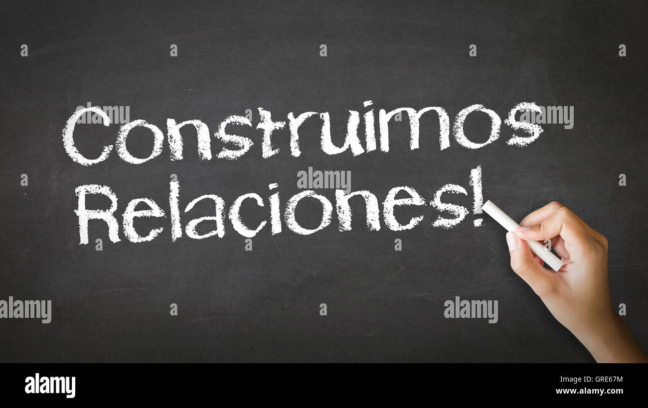 We build Relationships (In Spanish) - Stock Image