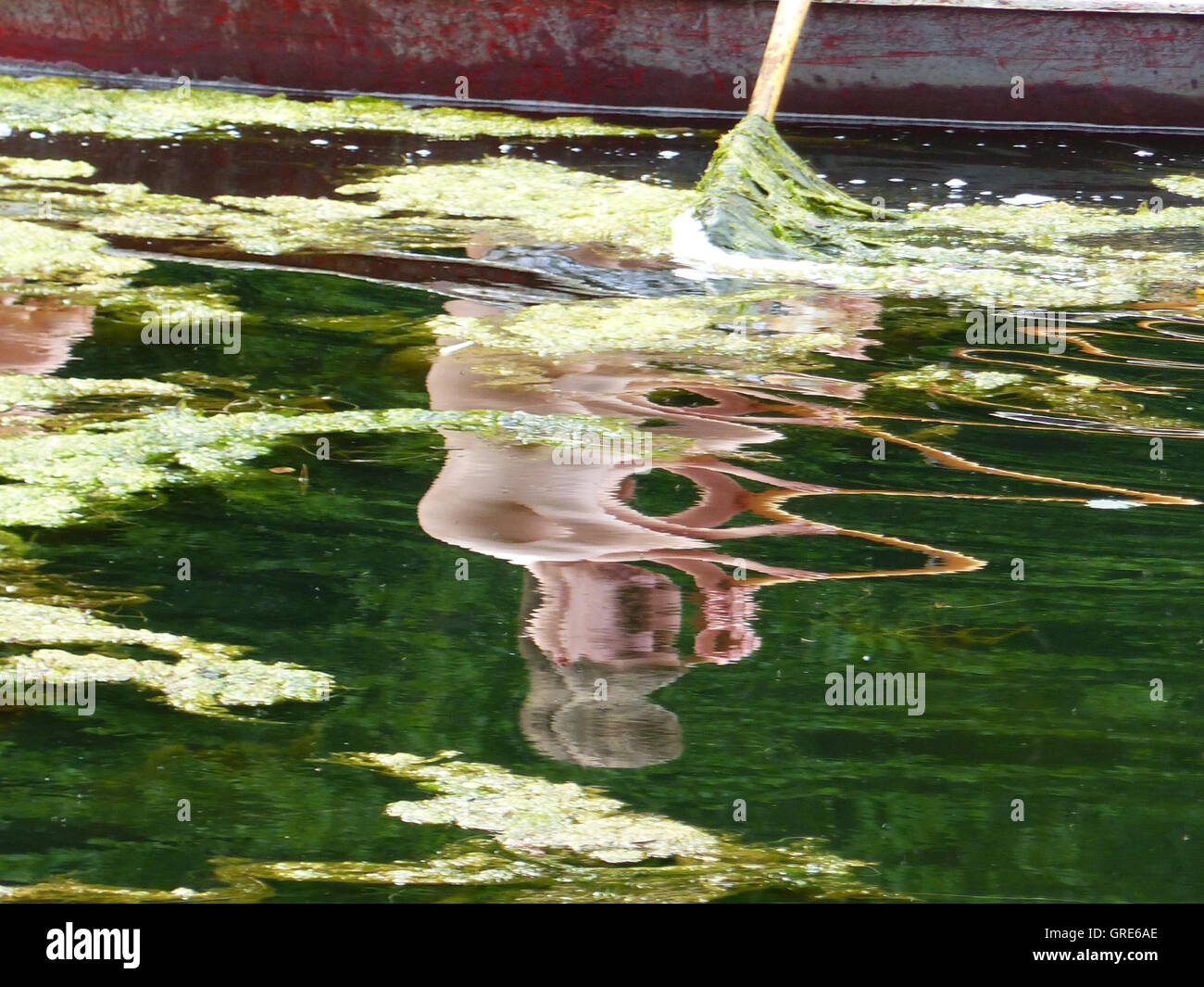 Distortion Of The Mirror Image In The Water By Wave Motion - Stock Image