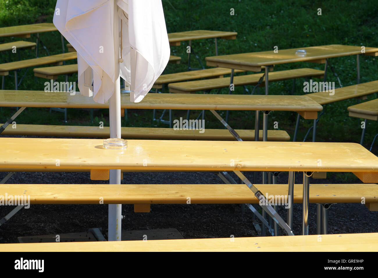 Beer Garden Beer Table Set With Sunshade After Rain & Beer Garden Beer Table Set With Sunshade After Rain Stock Photo ...