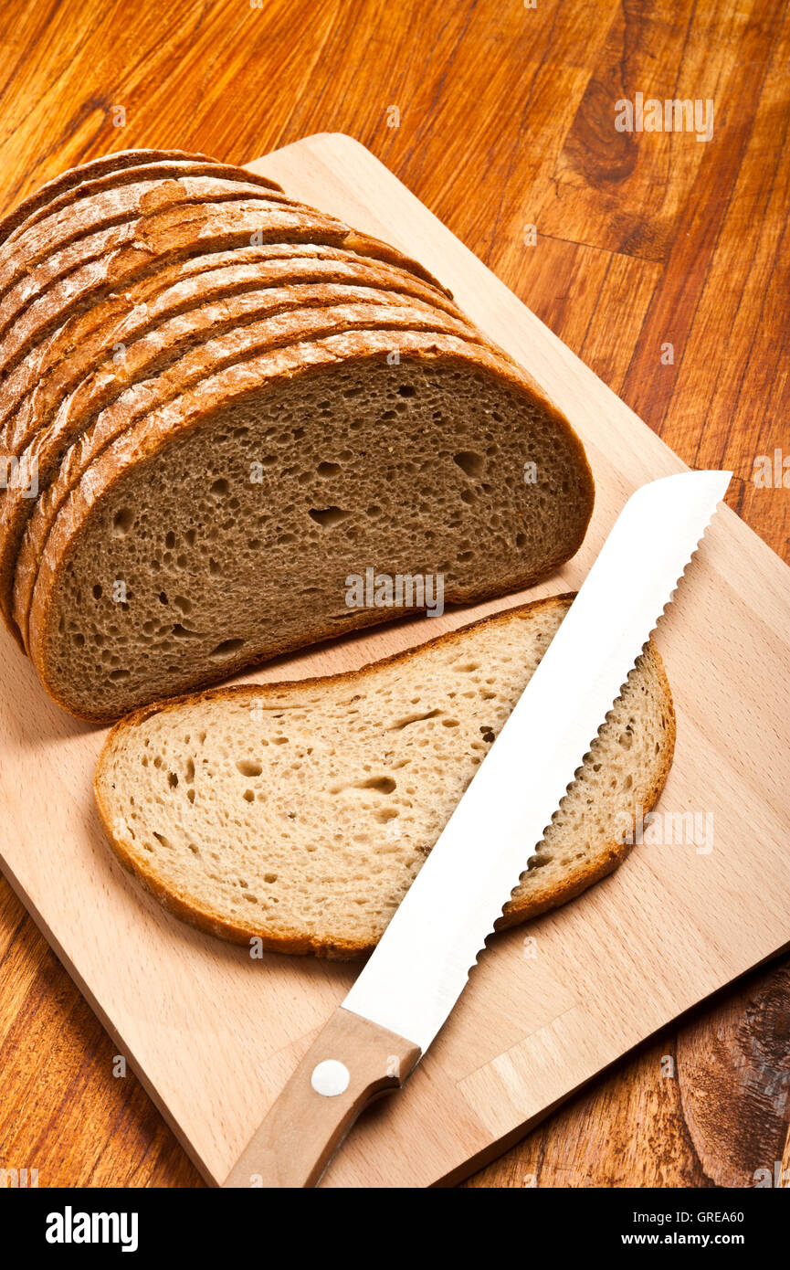 bread sliced on a cutter - Stock Image