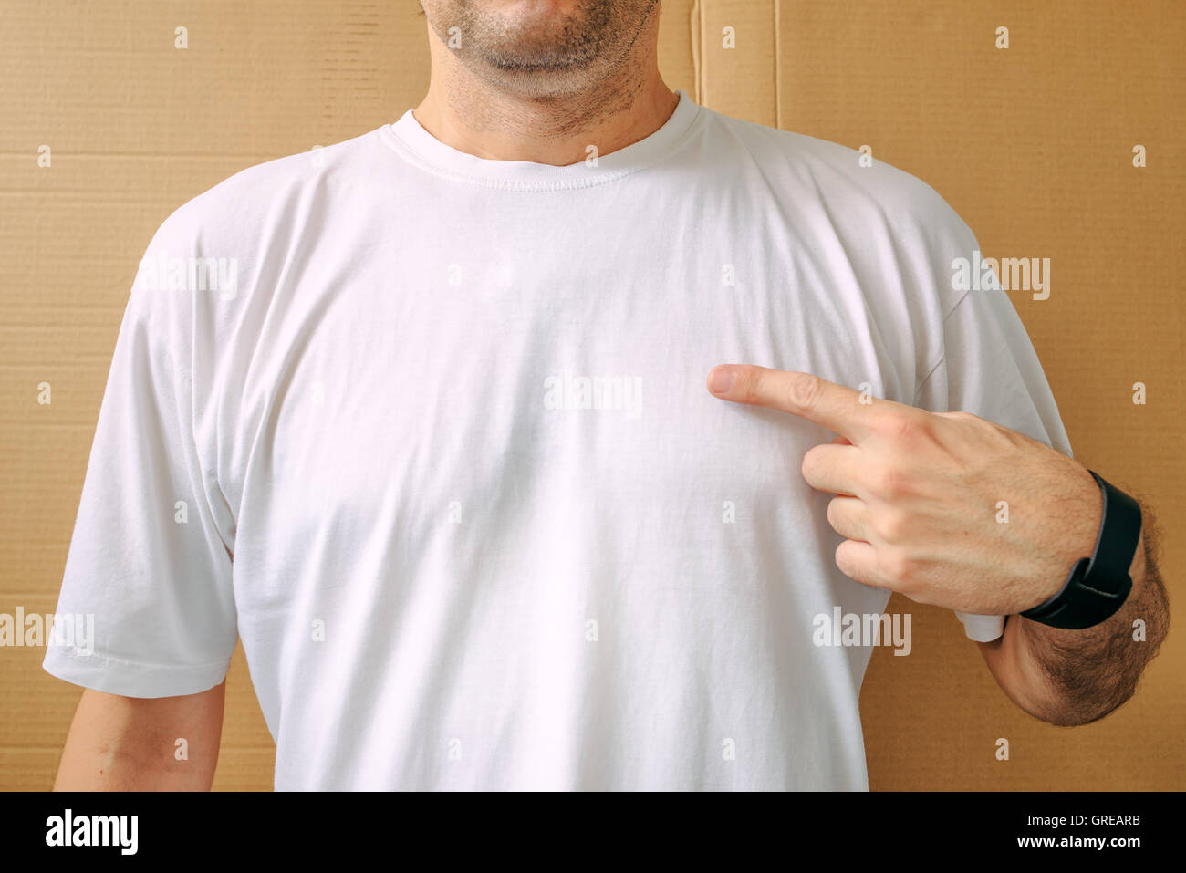 Man in white shirt, blank male t-shirt as copy space for mock up graphic design or text - Stock Image