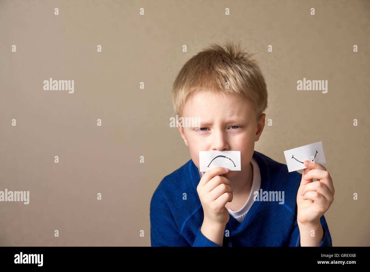 Young boy (teen) goes to stress, negative mood. Portrait with copy space - Stock Image