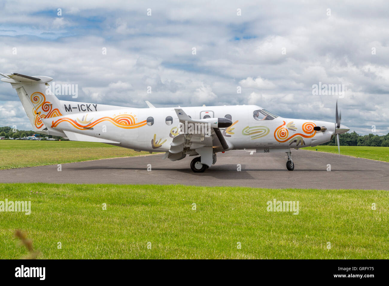 A Pilatus PC12 taxis for takeoff at Denham Airfield England UK - Stock Image