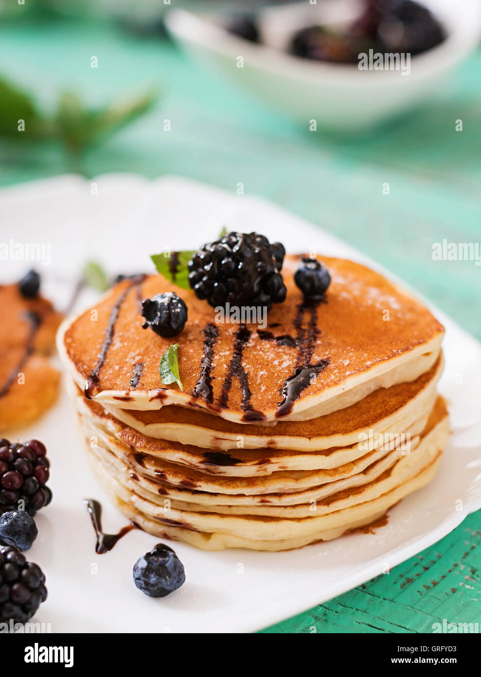 Delicious pancakes with blackberries and chocolate. - Stock Image