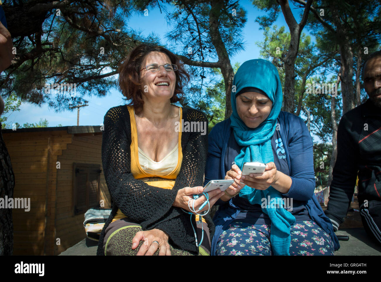 Efi Latsoudi with a fellow aid worker at PIKPA in Lesbos, Greece. - Stock Image