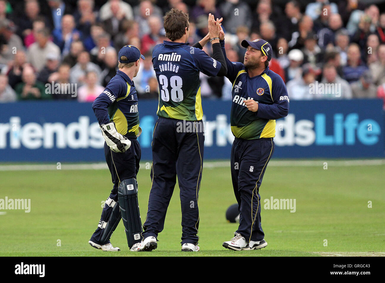 Essex players celebrate the wicket of Mark Cosgrove, bowled by Tim Southee - Essex Eagles vs Glamorgan Dragons  Stock Photo