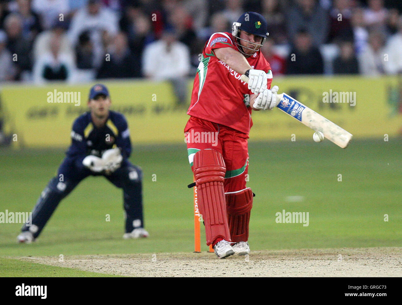 Mark Cosgrove in batting action for Glamorgan as James Foster looks on - Essex Eagles vs Glamorgan Dragons - Friends - Stock Image