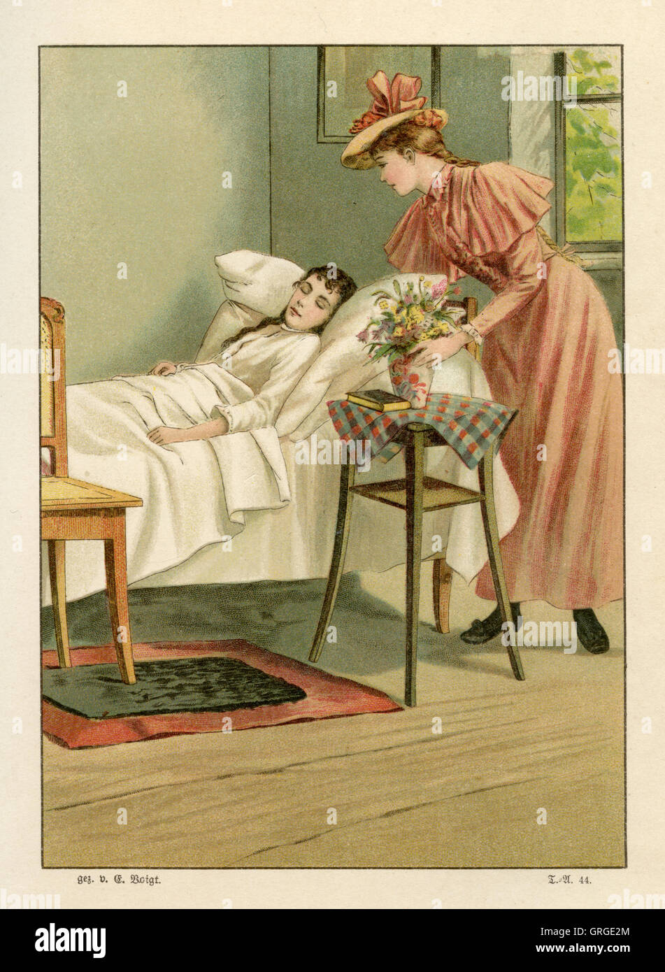 visiting a sick young woman at her bed Stock Photo