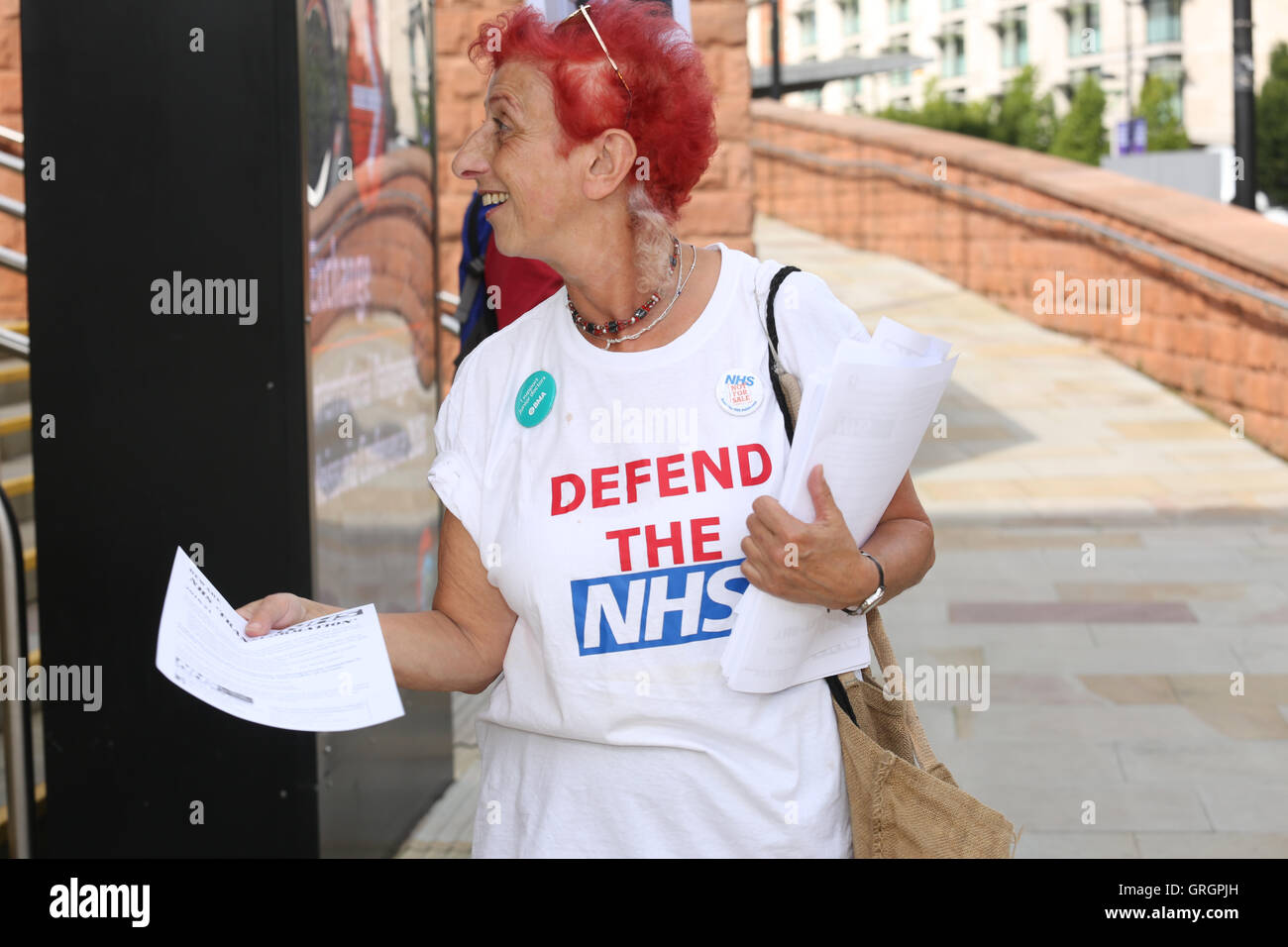 Manchester, UK. 7th September, 2016. A women wearing a shirt with the words 'Defend The NHS' printed on - Stock Image