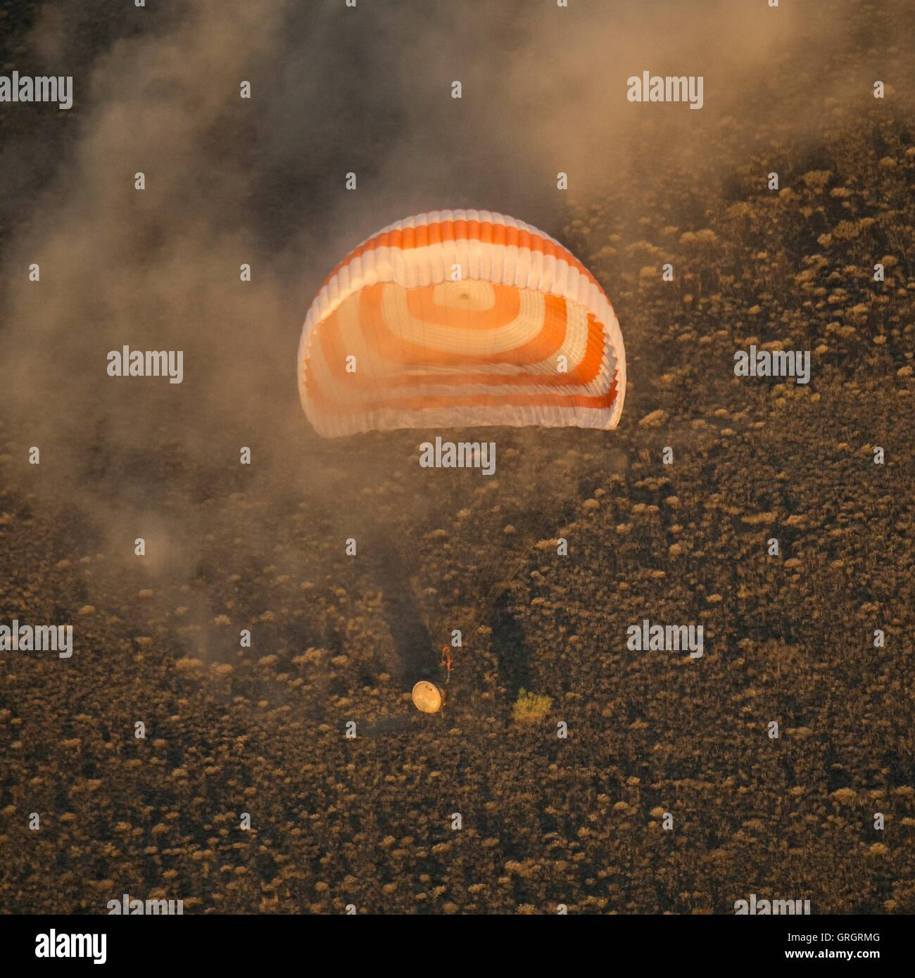 International Space Station crew from Expedition 48 touches down aboard the Russian Soyuz TMA-20M spacecraft to Stock Photo