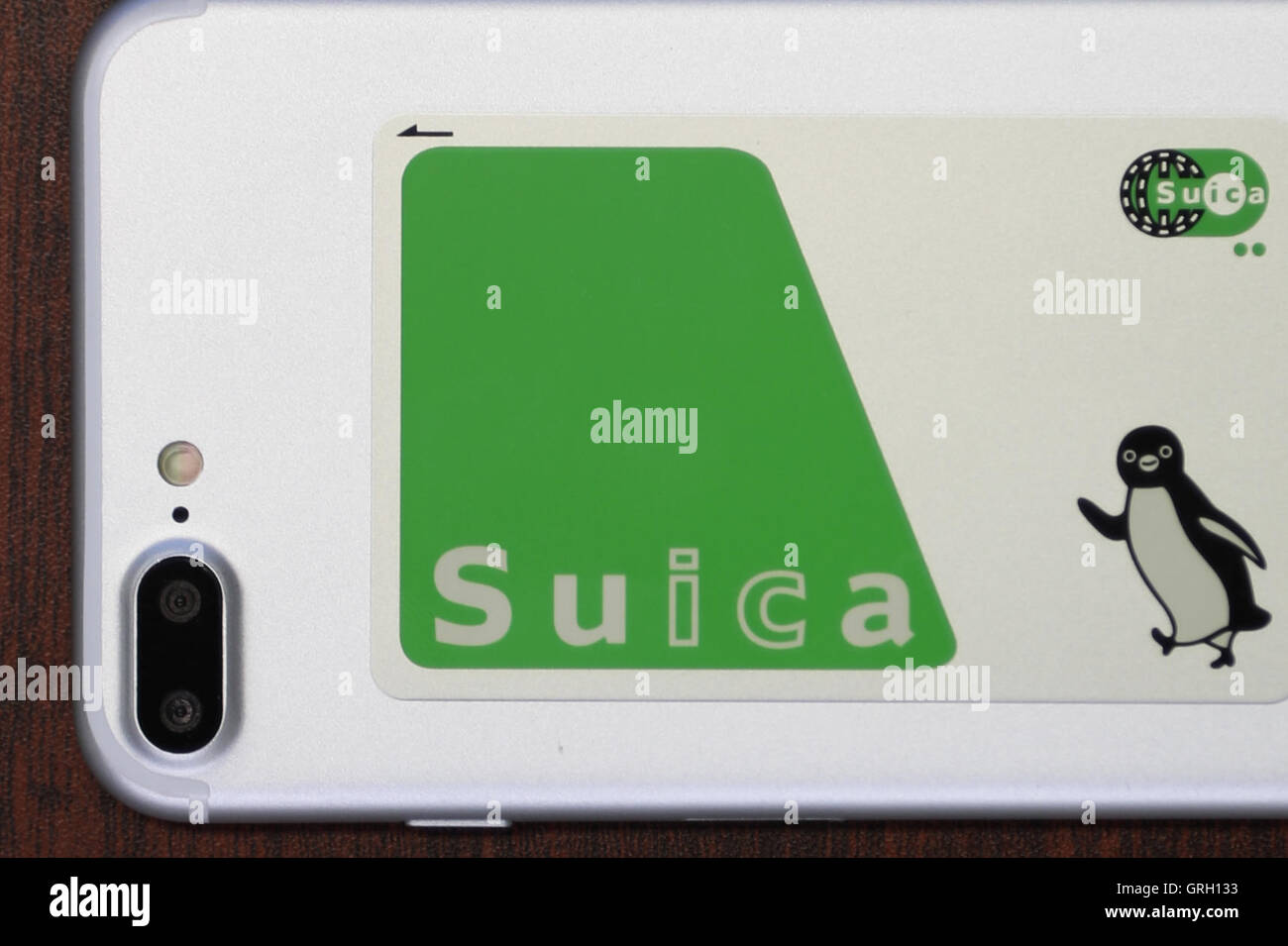 A Suica Travel Card On Top Of A Mock Up Of The New Iphone 7 Plus On