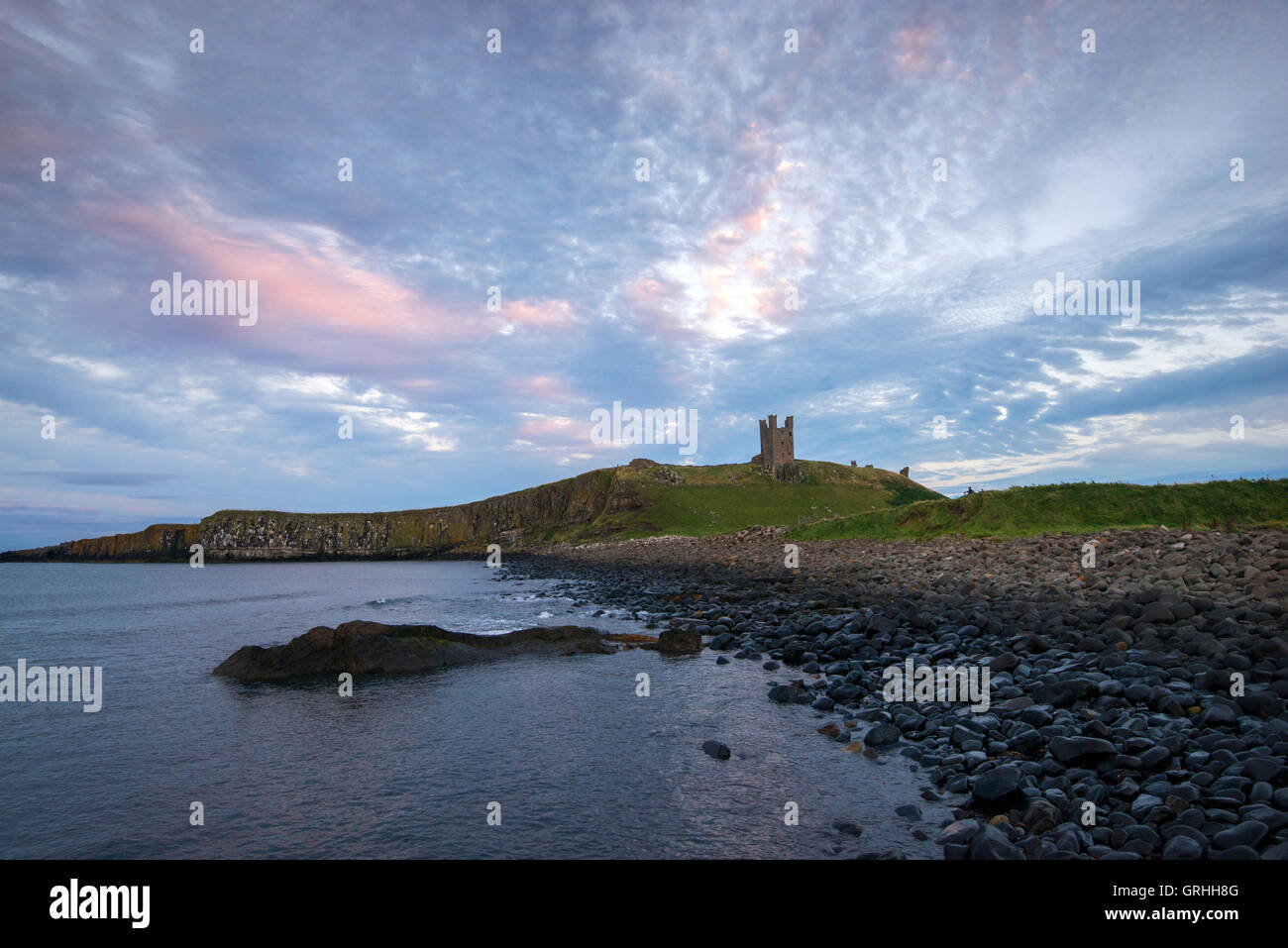 The ruins of Dunstanburgh Castle on the coast of Northumberland, England UK - Stock Image