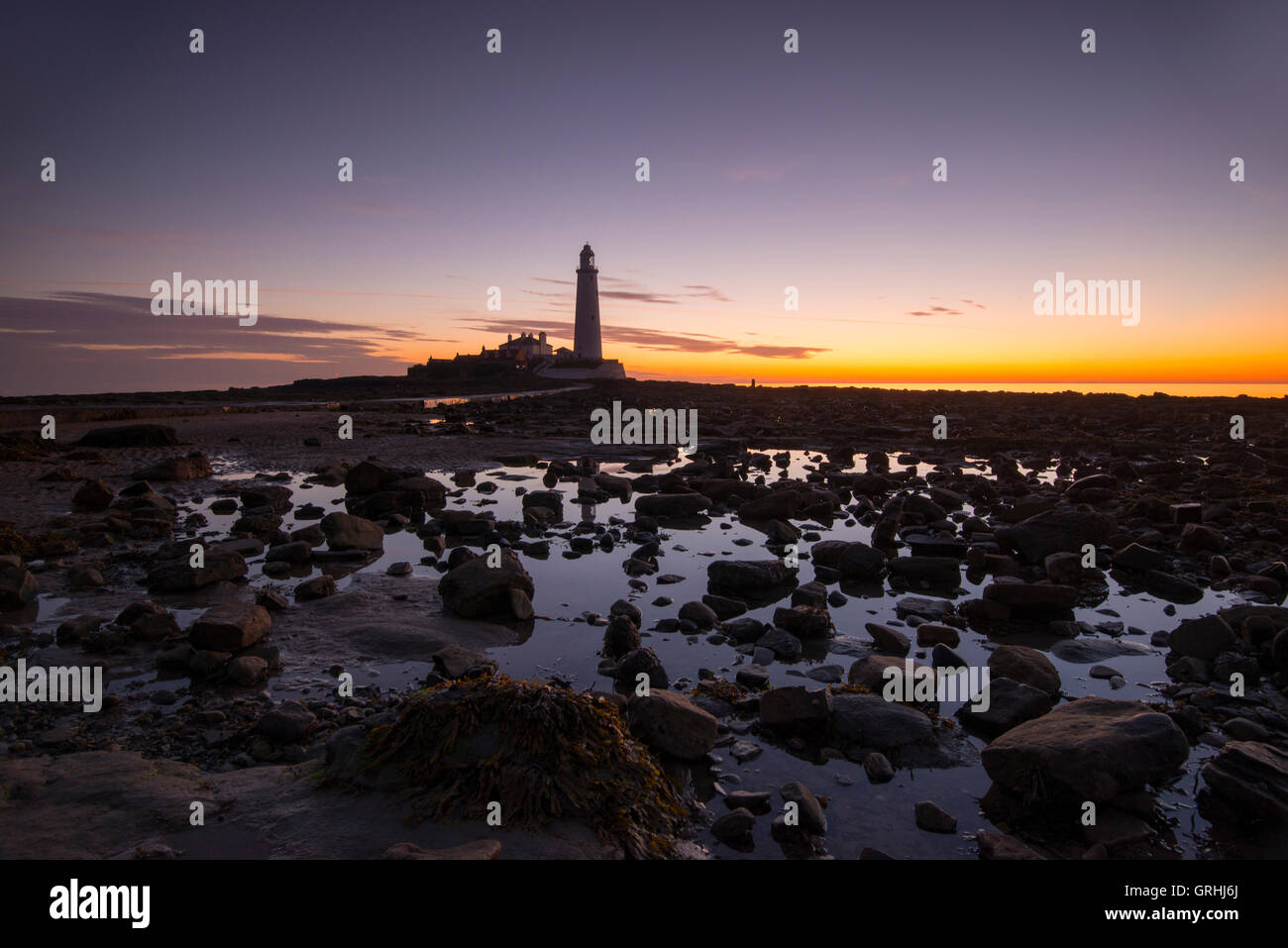 Sunrise at St Mary's Lighthouse, near Whitley Bay in Tyne and Wear England UK - Stock Image