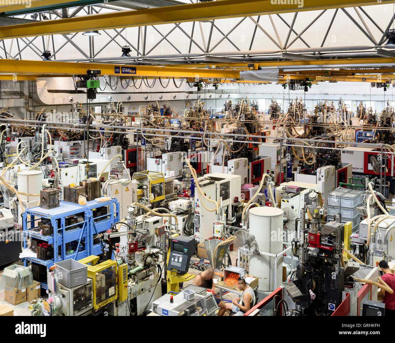 The injection moulding factory floor. Playmobil Factory, Valetta, Malta. Architect: -, 1976. Stock Photo
