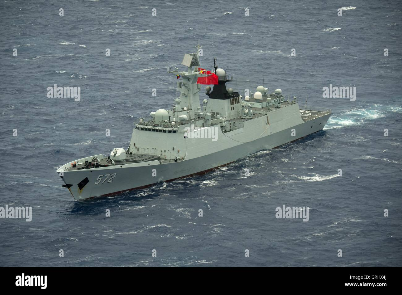 Chinese Navy multi-role frigate Hengshui steams in close formation during Rim of the Pacific exercises July 28, - Stock Image