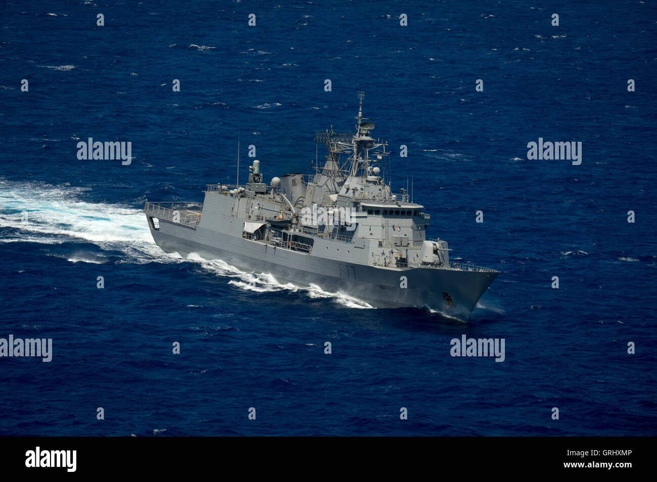 Royal New Zealand Navy ship HMNZS Te Kaha steams in close formation during Rim of the Pacific exercises July 28, - Stock Image
