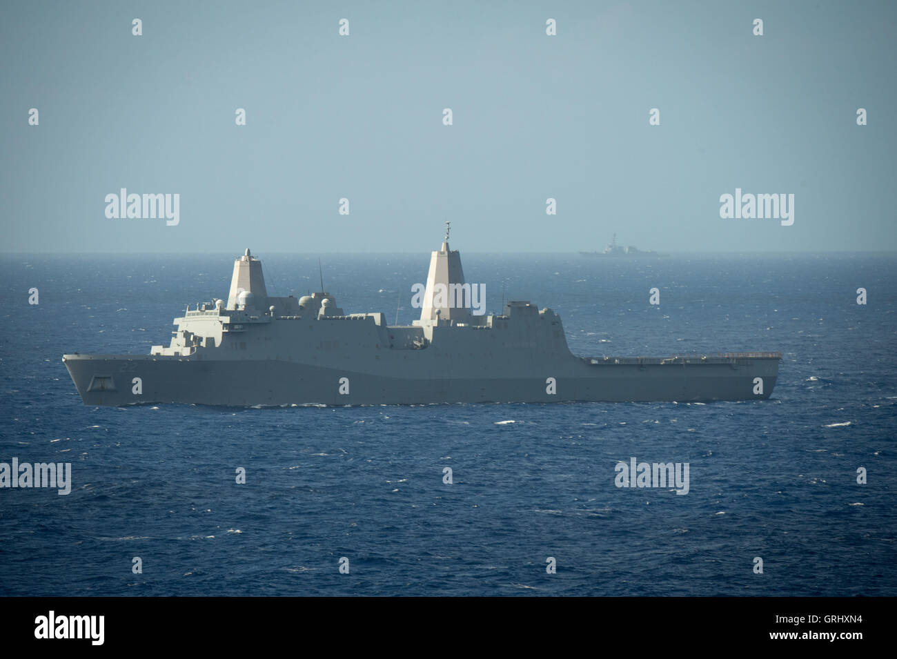 U.S. Navy Amphibious transport dock ship USS San Diego steams in close formation during Rim of the Pacific exercises - Stock Image