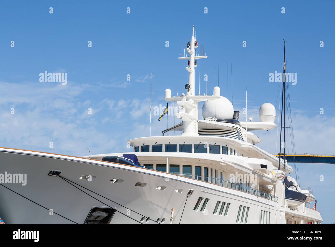 A huge white custom private yacht docked in Curacao - Stock Image
