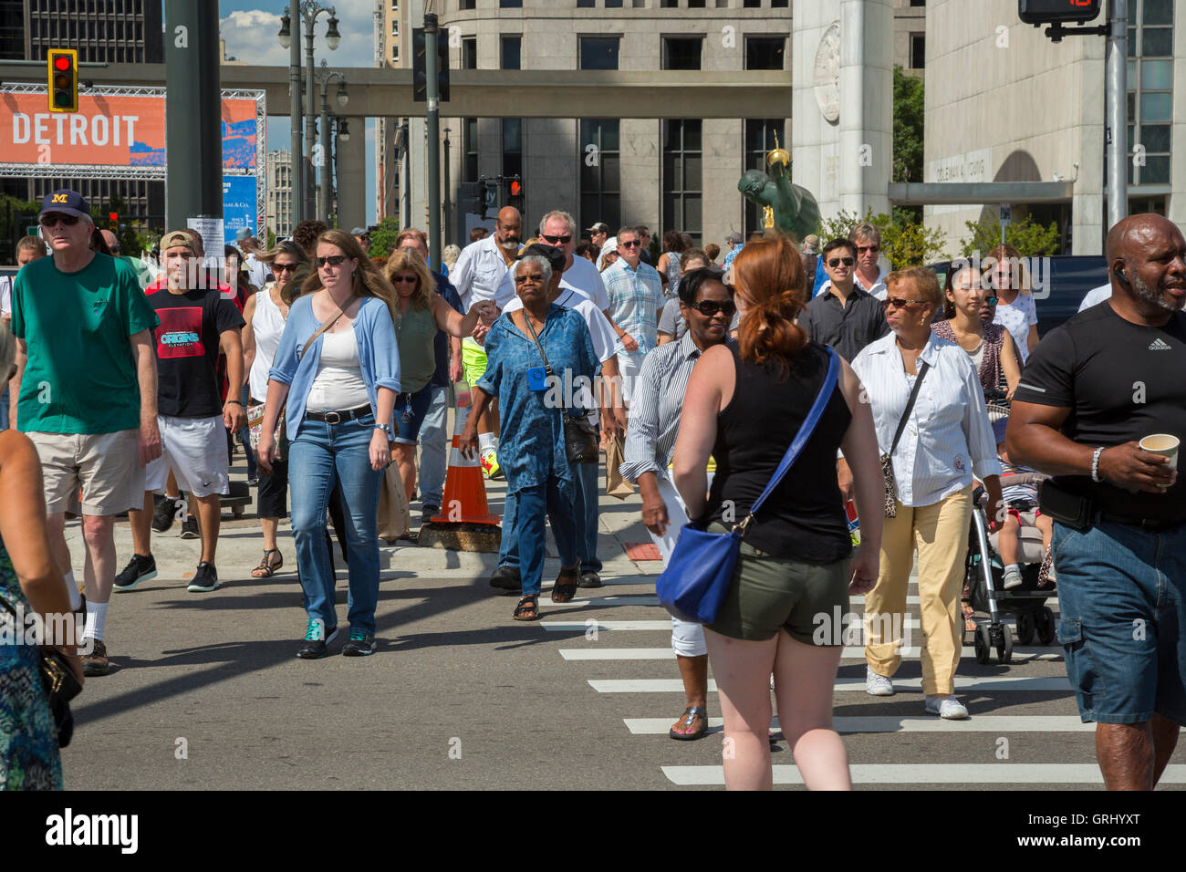 Detroit, Michigan - People cross a street on their way to the Detroit Jazz Festival. - Stock Image