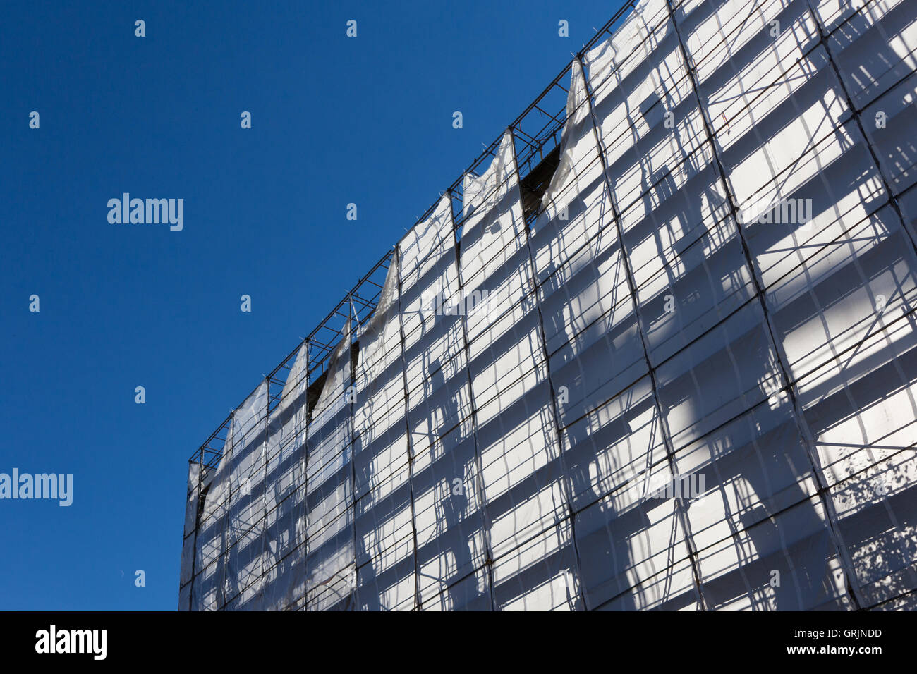 construction industry  building with scaffolding silhouette - Stock Image