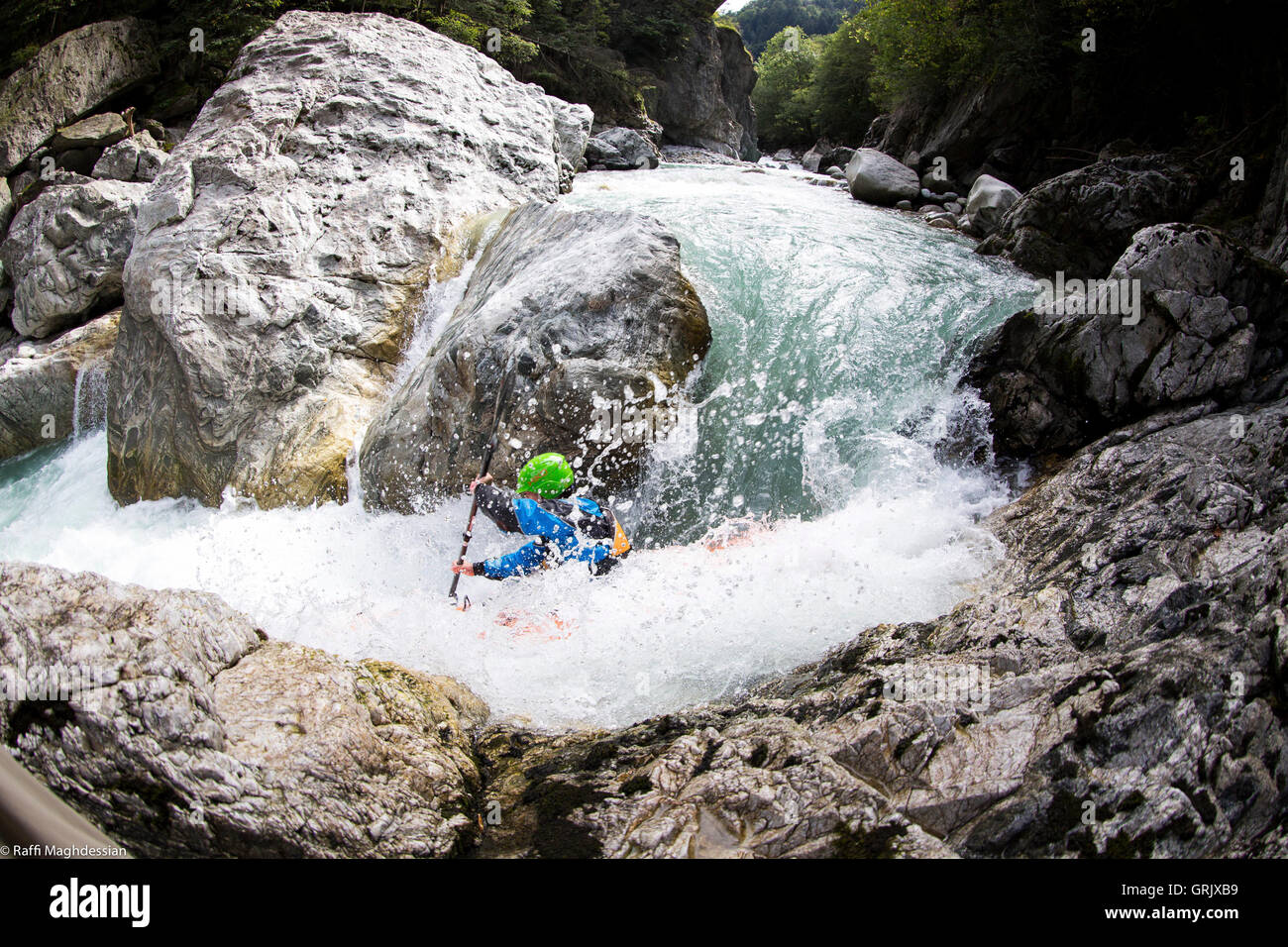 a tricky bend in kayak, Reusse River, Switzerland - Stock Image