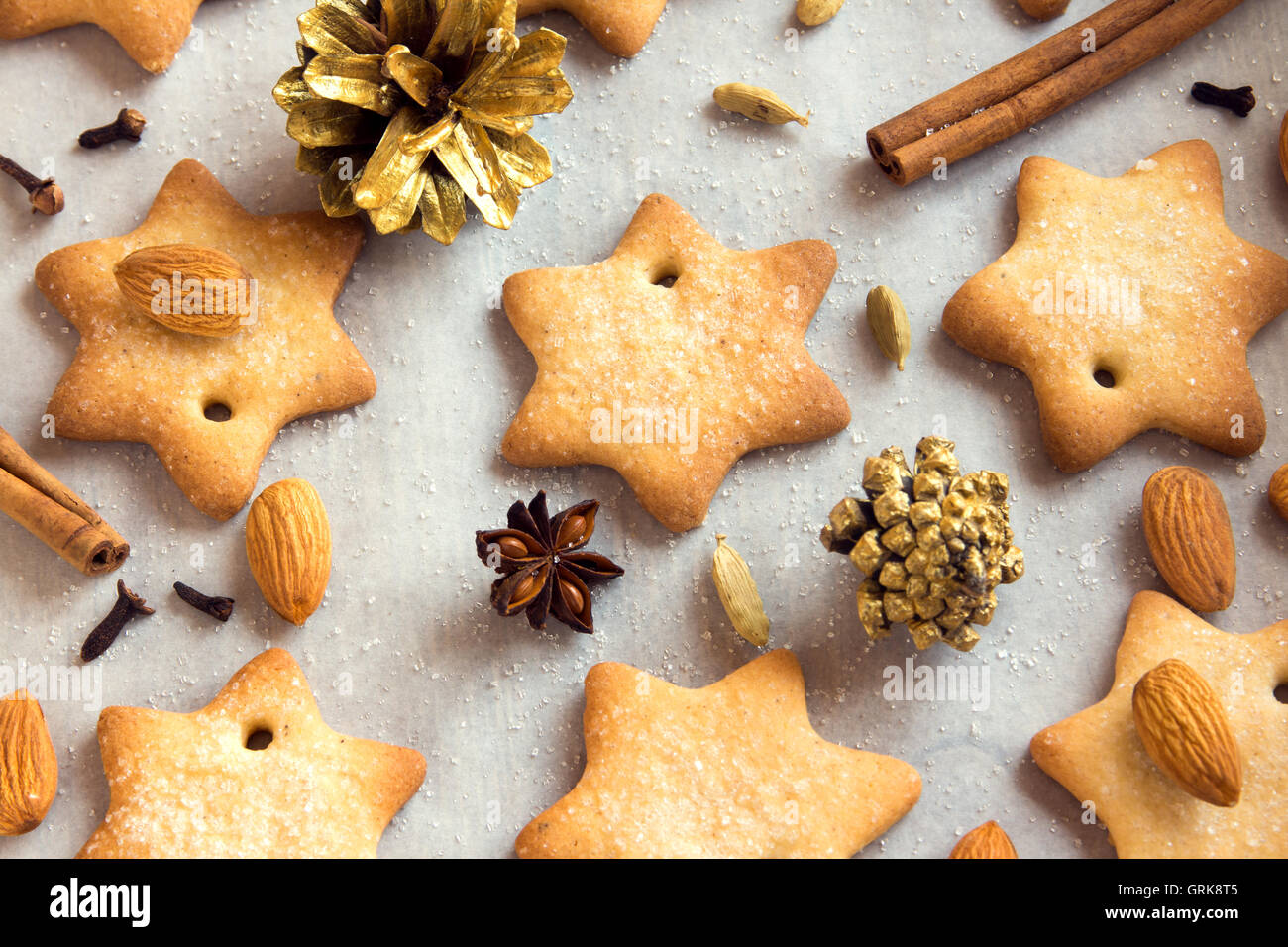 Christmas cookies and spices on baking paper - homemade winter bakery - Stock Image
