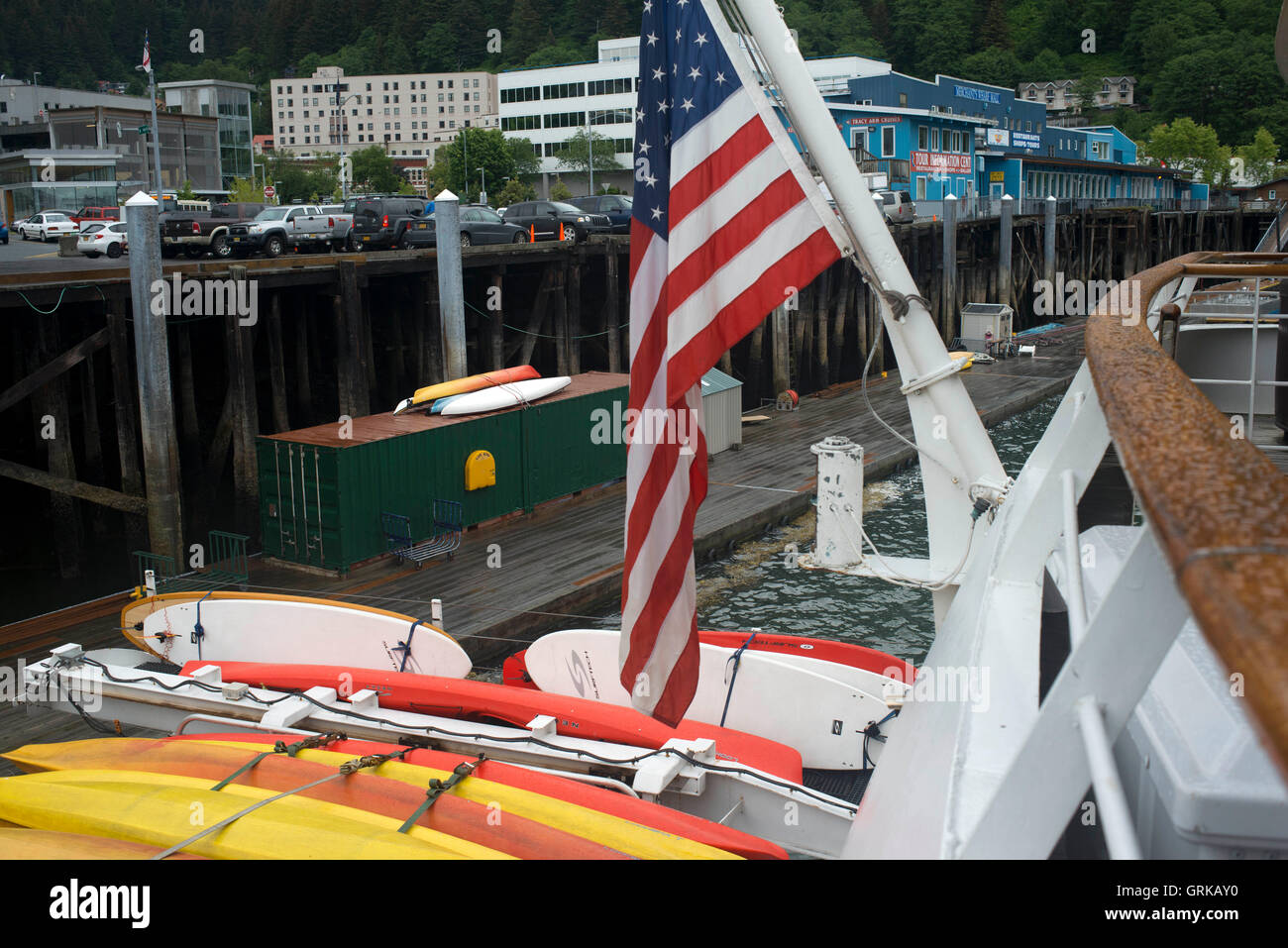 Cruises docked at the water front in Juneau dock Alaska. Downtown Juneau sits snugly between Mount Juneau, Mount Stock Photo
