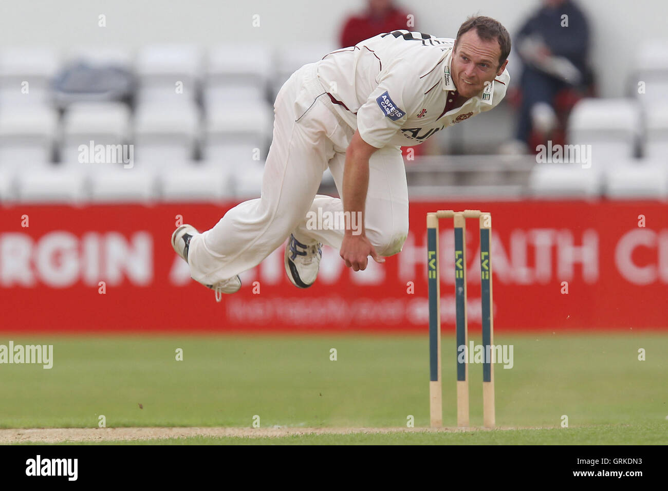 Lee Daggett in bowling action for Northants - Northamptonshire CCC vs Essex CCC - LV County Championship Division - Stock Image