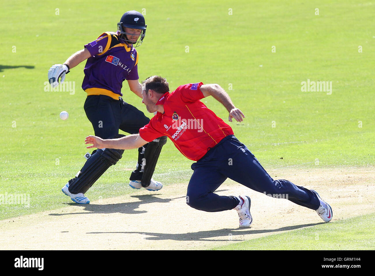 David Masters dives to the field the ball as Adam Lyth takes evasive action - Yorkshire Vikings vs Essex Eagles - Stock Image