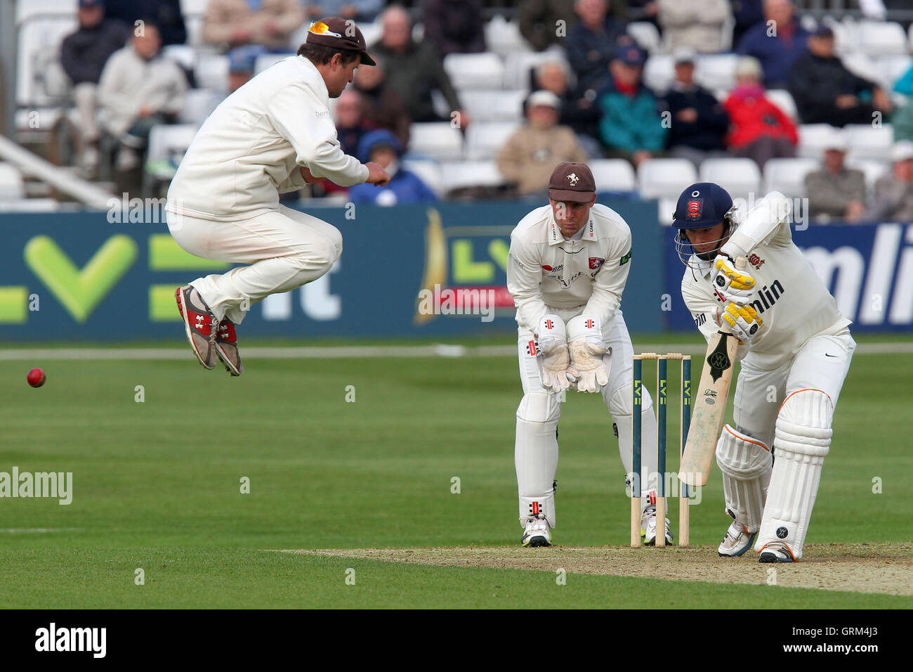 Rob Key of Kent takes evasive action as Essex batsman Tom Craddock hits out - Essex CCC vs Kent CCC - LV County - Stock Image