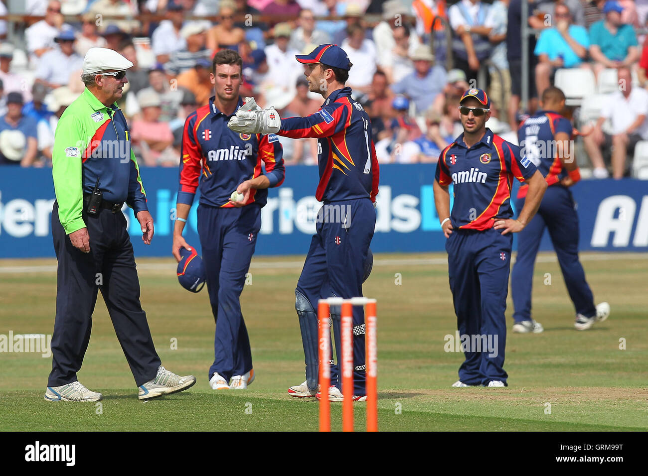 James Foster of Essex (C) protests to umpire George Sharp after 12 penalty runs are added to the Sussex score for - Stock Image