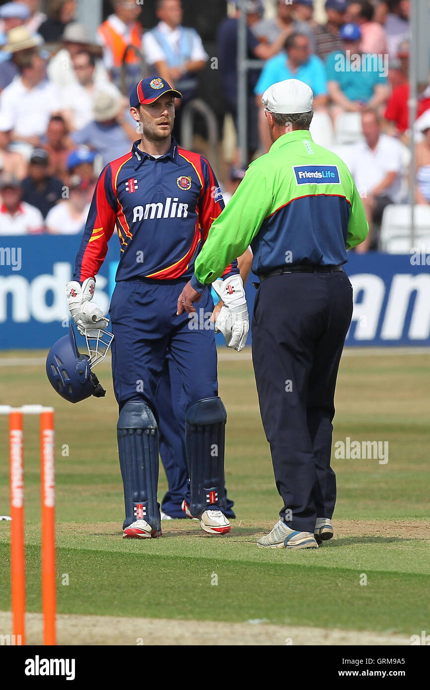 James Foster of Essex (L) protests to umpire George Sharp after 12 penalty runs are added to the Sussex score for - Stock Image