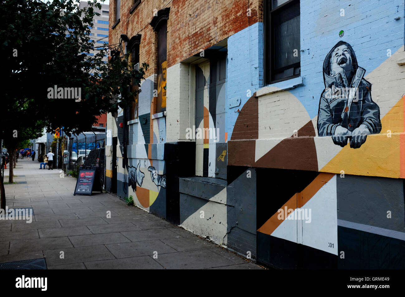Mural of a child laughing along Christopher Columbus Drive in Historic Downtown,Jersey City,New Jersey,USA - Stock Image