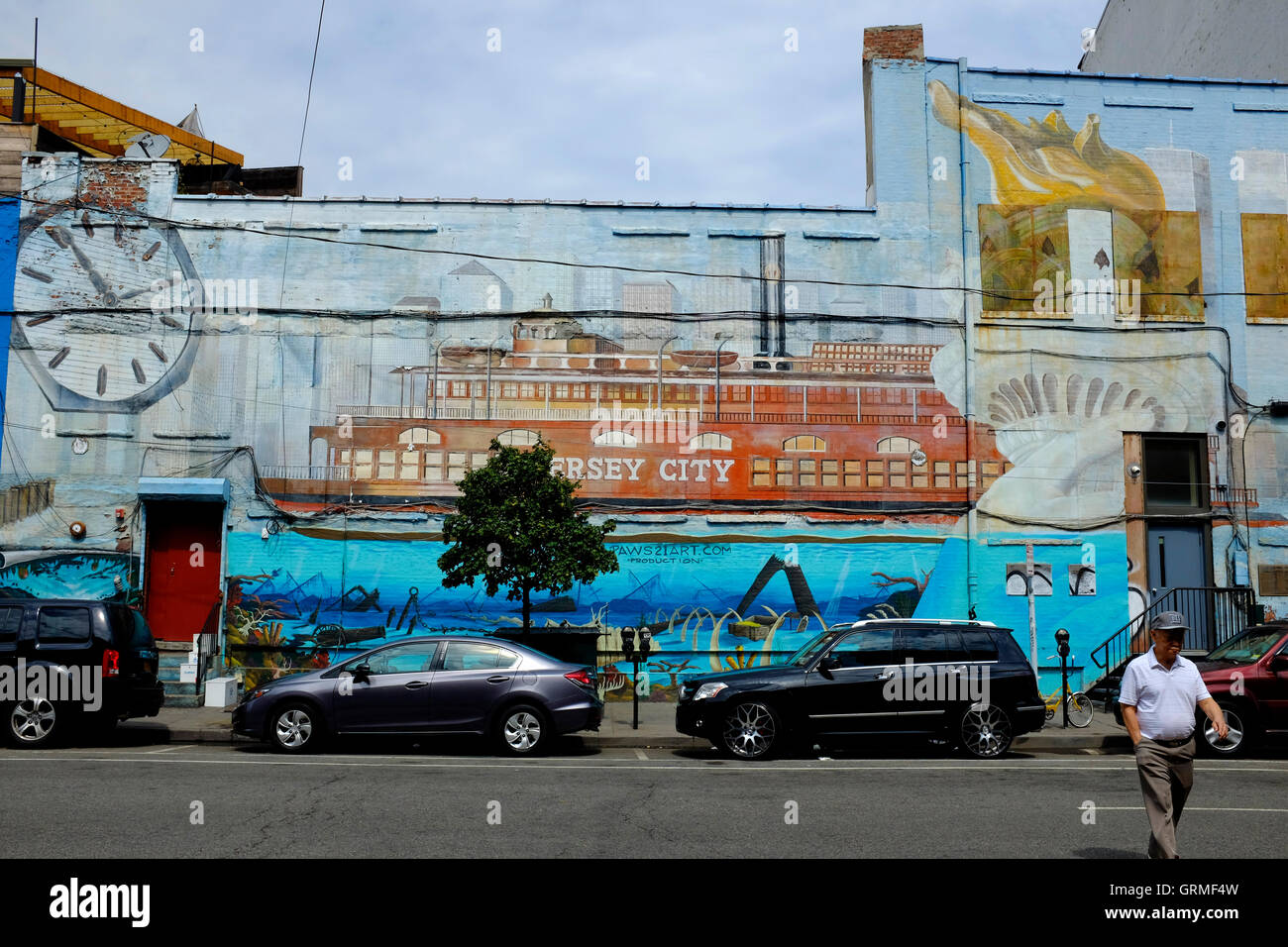 Mural on building facade along Christopher Columbus Drive.Jersey City,New Jersey,USA - Stock Image