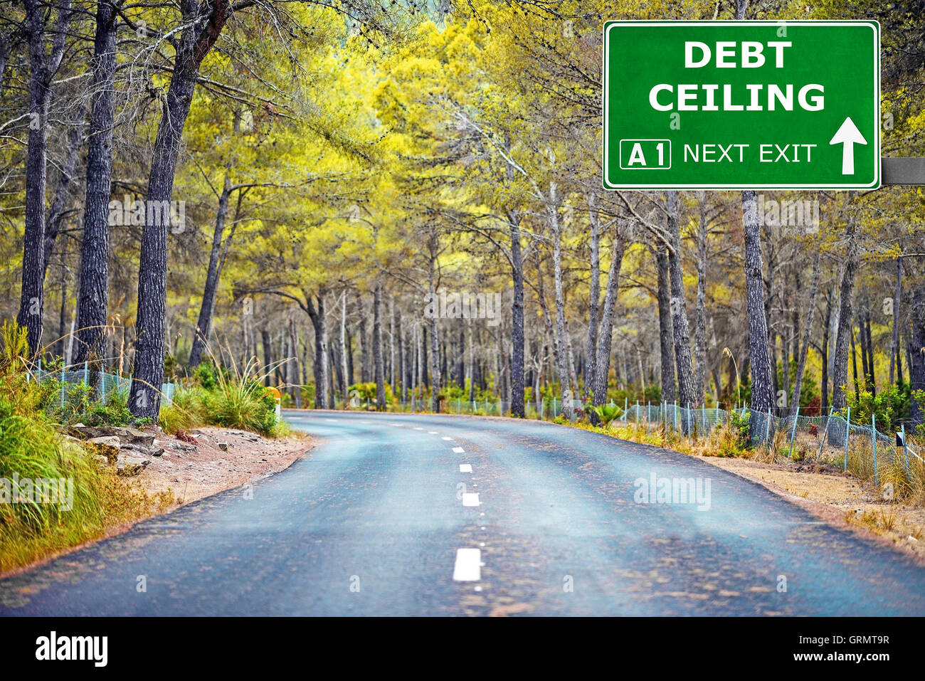 DEBT CEILING road sign against clear blue sky - Stock Image