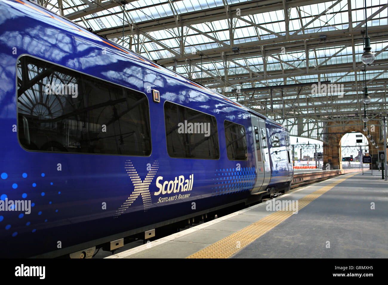 GLASGOW, SCOTLAND, UK - JULY 12, 2013: A ScotRail train at the platform at Queen Street station in Glasgow. - Stock Image