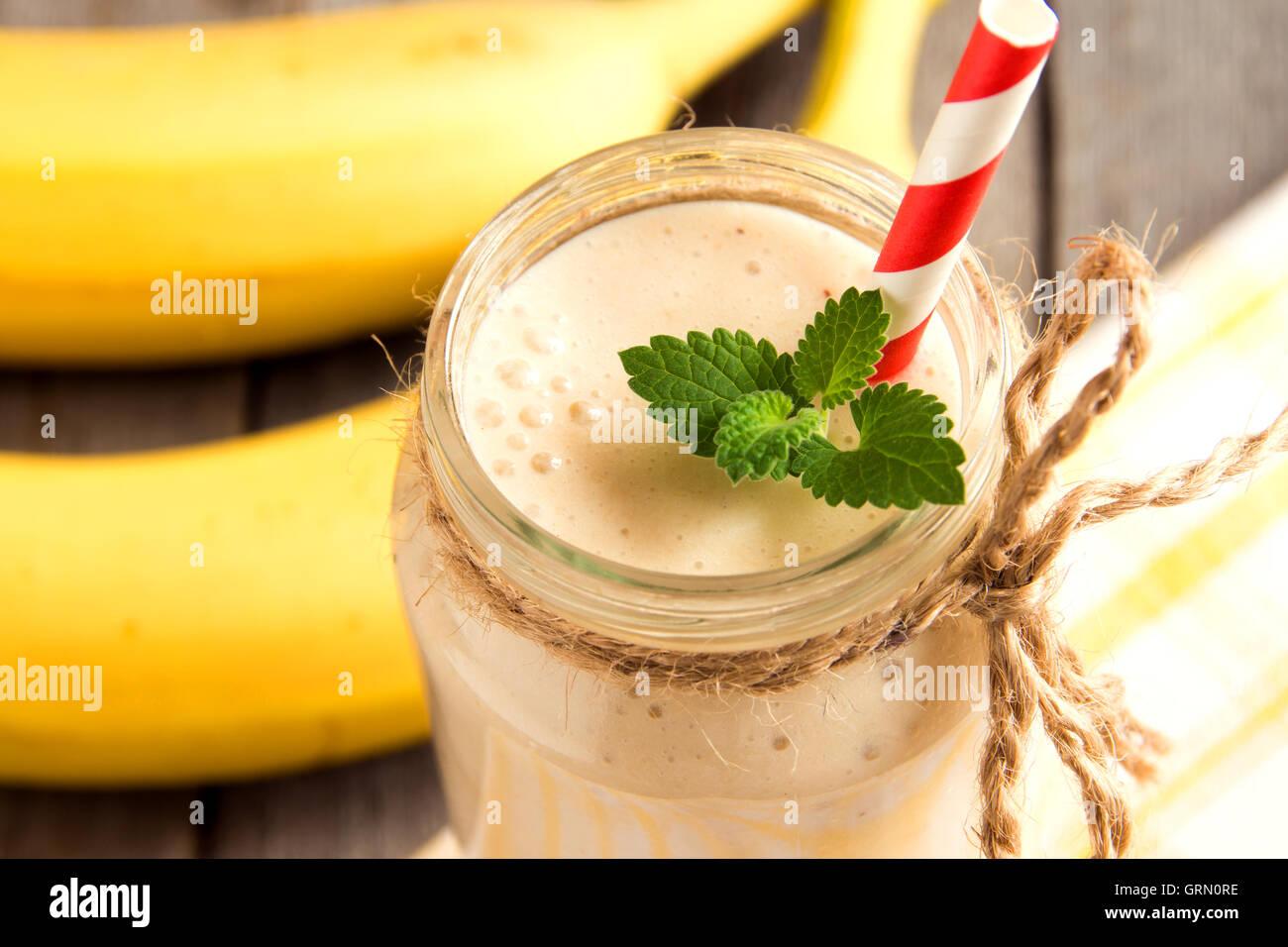 Banana smoothie on wooden background Stock Photo