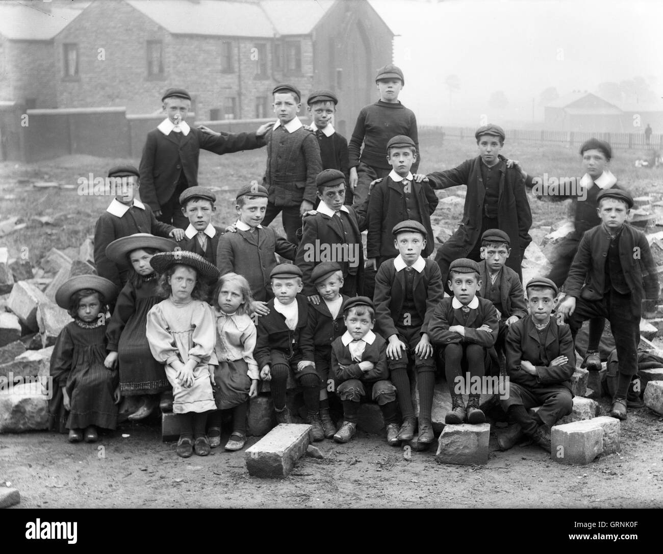Sunday school children some wearing clogs and caps in Lancashire England Britain - Stock Image