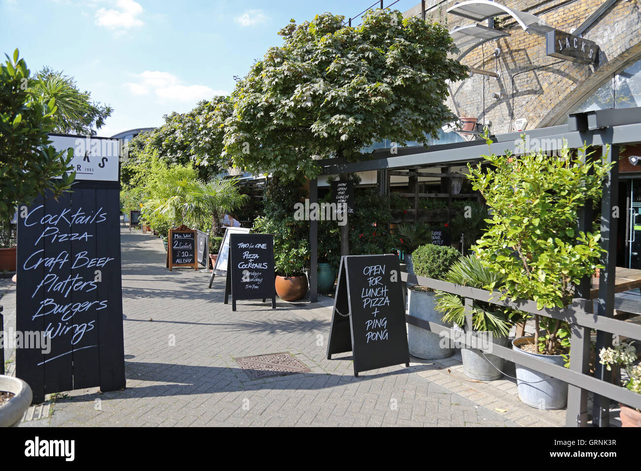 Blackboards outside restaurants on London's Isabella Street. Built underneath railway arches, the street is - Stock Image