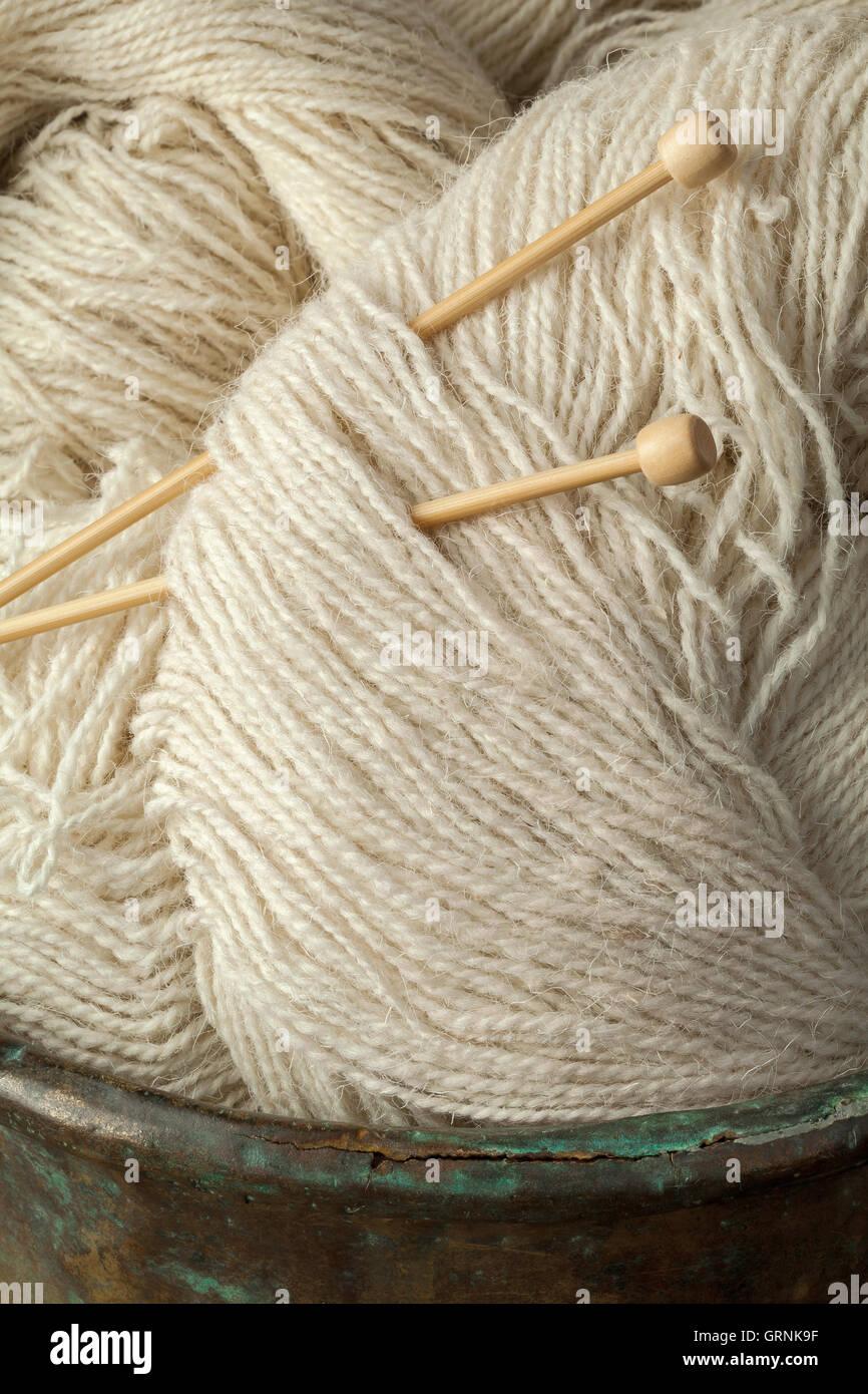Natural handmade sheep wool yarn - Stock Image