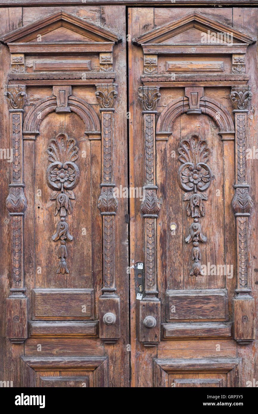 Ancient old entrance door looking like shabby chic texture background - Stock Image