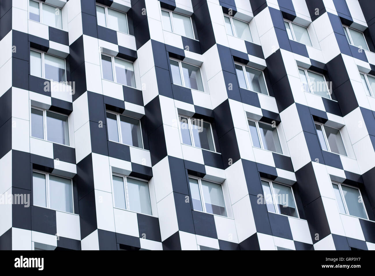 Black and white minimalistic bauhaus office building of business center - chequered background - Stock Image