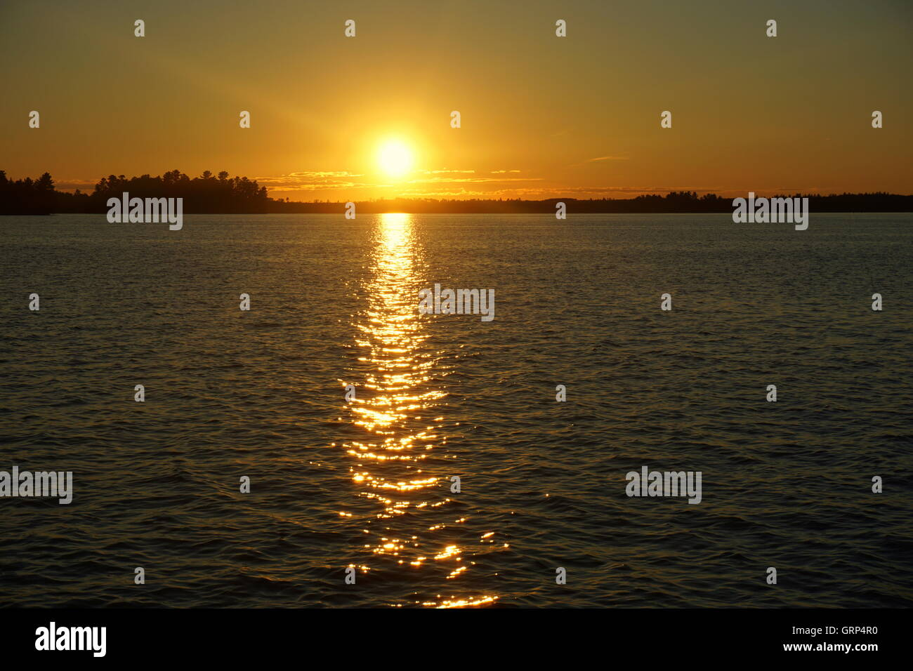 PELICAN LAKE SUNSETS - Stock Image