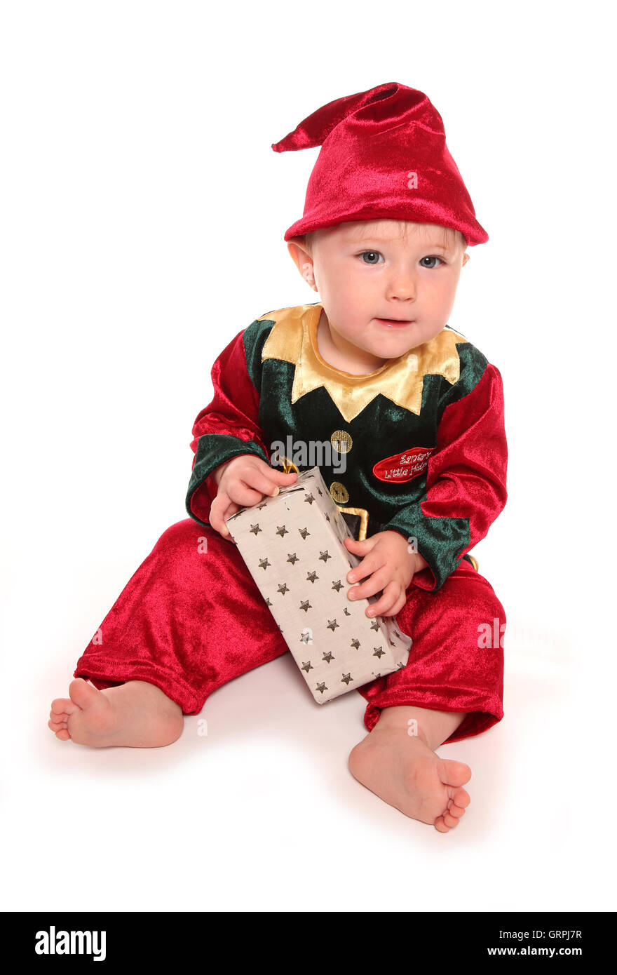 infant dressed in elfs santas little helper fancy dress costume cutout - Stock Image