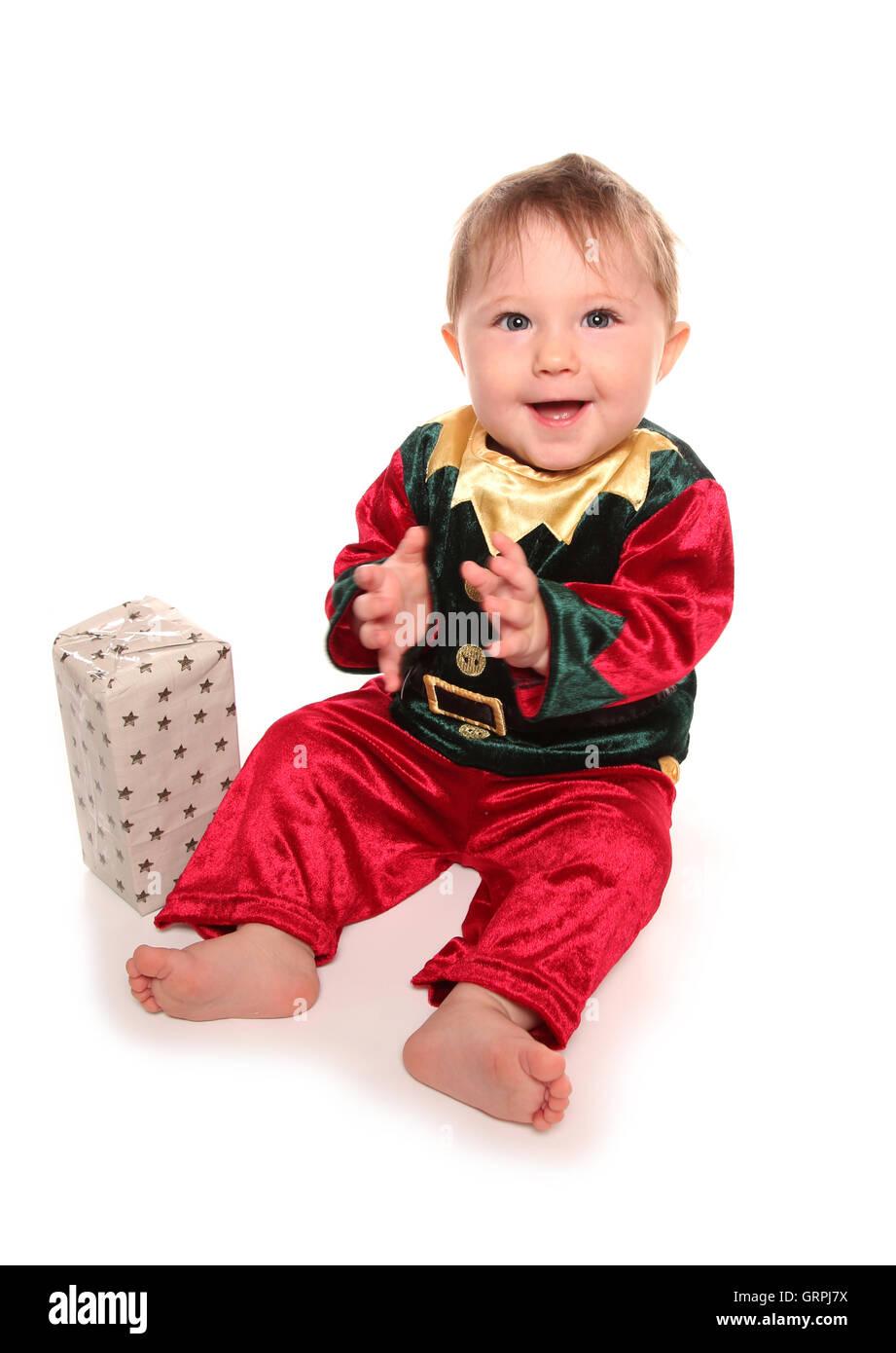 infant dressed in elfs santas little helper fancy dress costume cutout  sc 1 st  Alamy & infant dressed in elfs santas little helper fancy dress costume ...