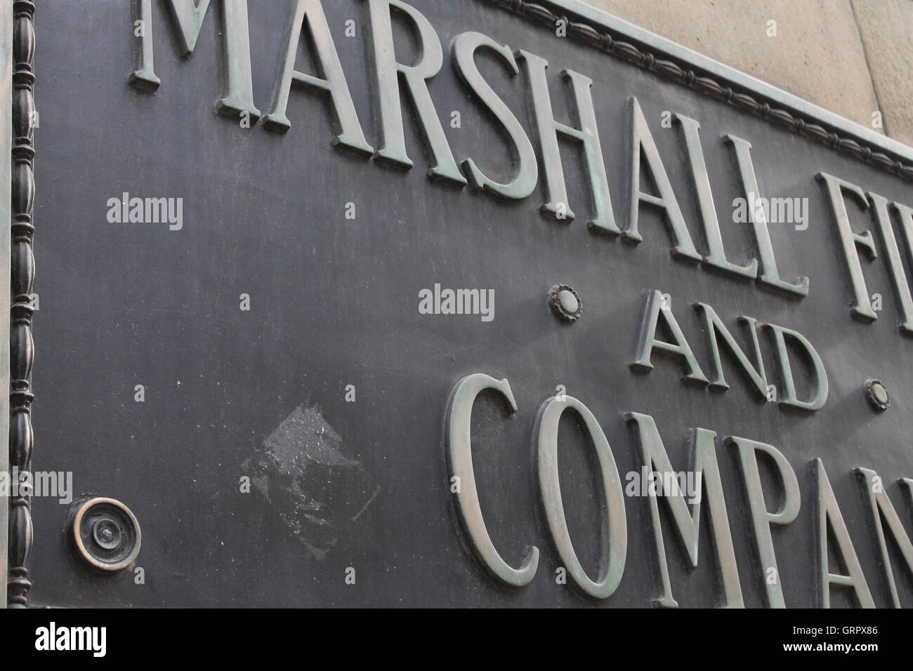 Marshall Field's plaque on the outside of what used to be Marshall Fields (now Macy's) in Chicago IL - Stock Image